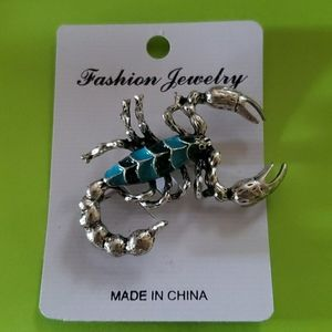 Silver and blue scorpion brooch